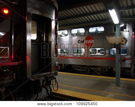 Caltrain Trains Sit In Station At Night At 4Th Street Station