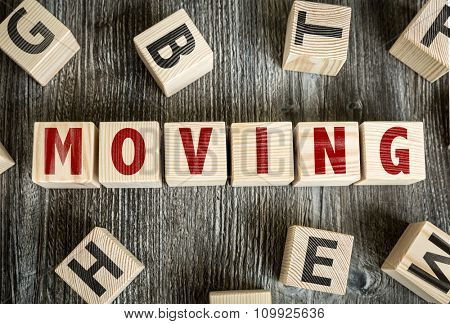 Wooden Blocks with the text: Moving