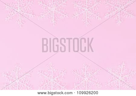 Snowflakes On A Pink Background