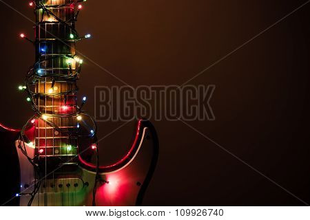 Electric Guitar Wrapped By Garland
