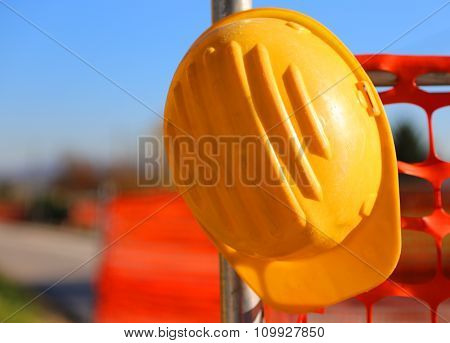 Hard Hat On The Road Construction Site During Road Works