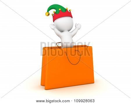 3D Character With Elf Hat Jumping Out Of Gift Bag