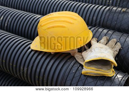 Hard Hat And Work Gloves In Construction Site