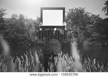 Businessman Holding Picture Frame Copy Space Concept
