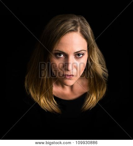 Dramatic woman looking at the camera surrounded by black