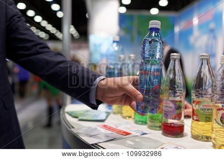 ST. PETERSBURG, RUSSIA - NOVEMBER 18, 2015: Soft drinks in the International food exhibition PeterFood. The exhibition is setting up contacts between food manufacturers and retail networks