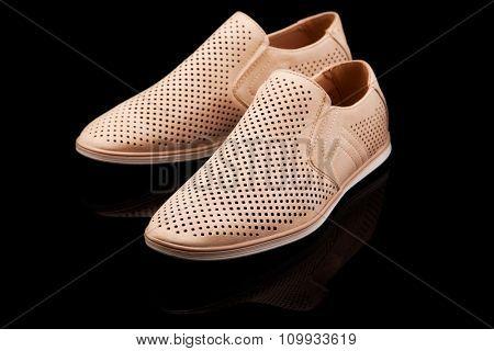 men beige summer shoes on a black background