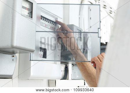 Electrician repairs dashboard.