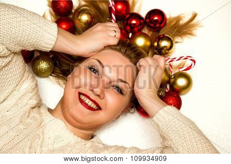Beautiful Blonde With A Christmas Candies Lying On A White Background.