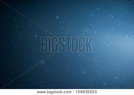 winter night scene, falling snow background snowflakes in blur over dark background