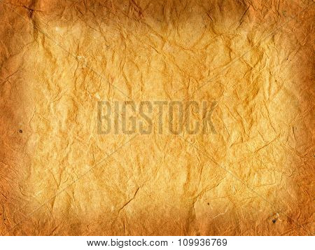 Old brown wrinkled brown rice paper. Burned brown edges gradient.