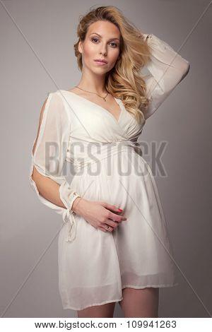 Pregnant Woman In Studio.