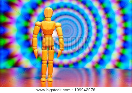Wooden dummy, mannequin or man figurine, silhouette stand against the backdrop of hipnotic, trance b