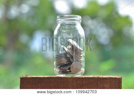 Jar For Savings Full Of Coins.