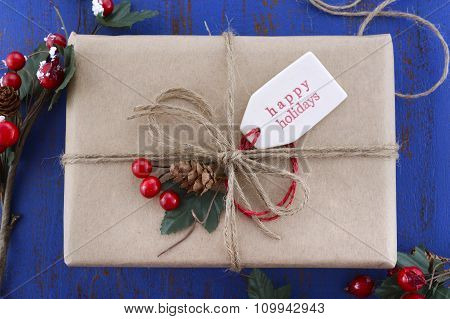 Gift Wrapping Presents On Dark Blue Table.