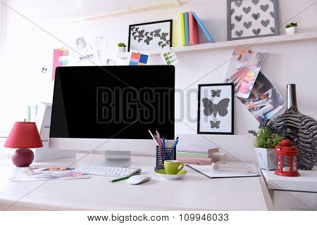 Modern computer on the table in decorated room