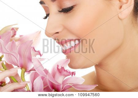Young beautiful woman with pink flower.