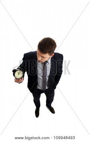 Handsome businessman with alarm clock.