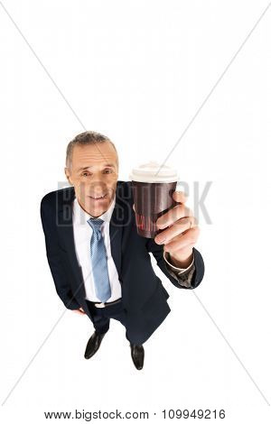 Smiling mature businessman with a cup of coffee.
