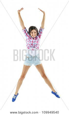 Active girl jumping in joy, isolated on white