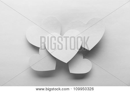 White hearts on white paper background
