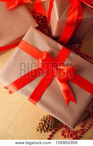 Beautiful gifts with bows on wooden background