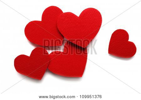 Red hearts on white paper background