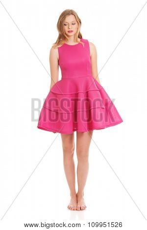 Beautiful teenage woman with pink skirt