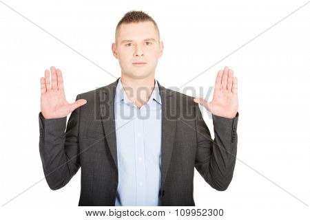 Young handsome businessman pressing abstract screen.