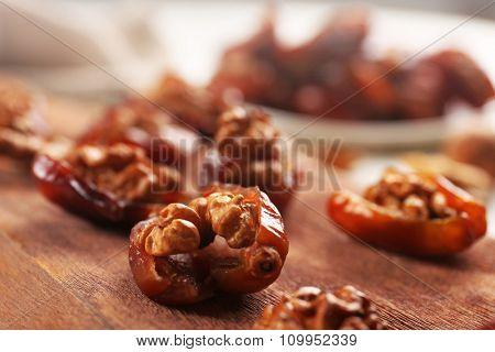 Walnut in date fruit on cutting board, close-up