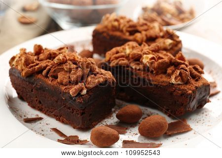 Pieces of chocolate cake with walnut on the table, close-up