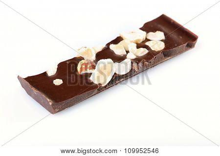 Black chocolate piece isolated on white background