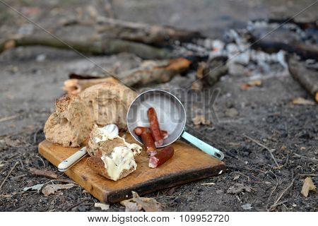 Grilled sausages on cutting board in the wood