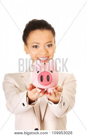 African business woman with a piggybank.