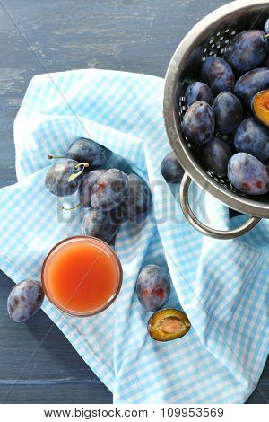 Plum Juice in a glass with fresh fruits