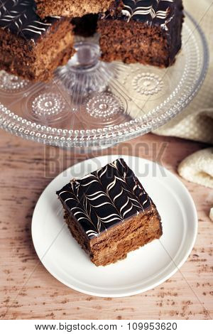 Served table with chocolate cake on wooden background