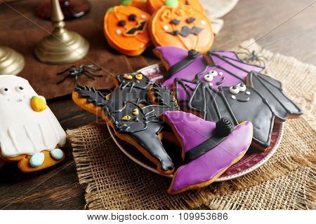 Creative Halloween cookies on wooden background