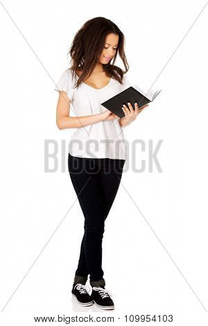 Young african student woman reading book.