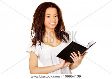Young african student woman with notebook.