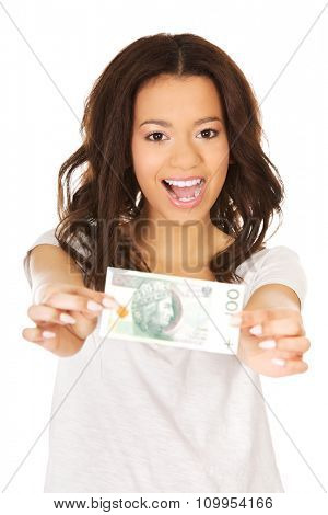Happy african woman holding polish bill.