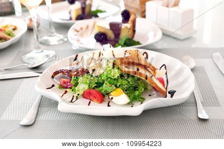 Tasty salad on white served table