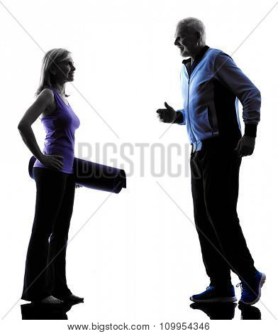 one caucasian couple senior fitness exercises silhouette  in silhouette studio isolated on white background