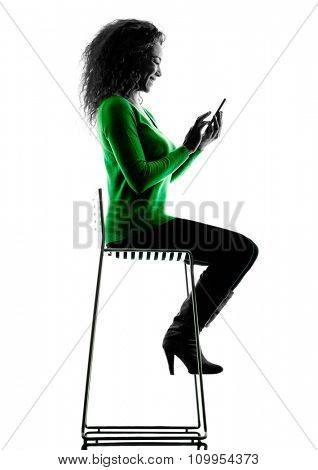 one mixed race young woman Telephones silhouette isolated on white background