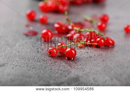 Fresh red currants on table close up