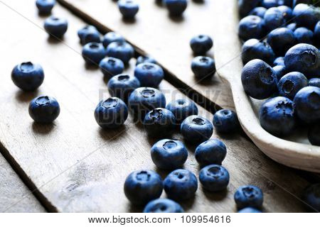 Tasty ripe blueberries on wooden table close up