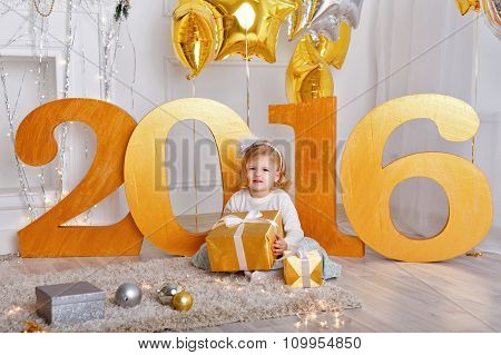 Little Girl With Gift For New Year 2016.
