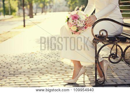 Beautiful wedding bouquet in hands of bride