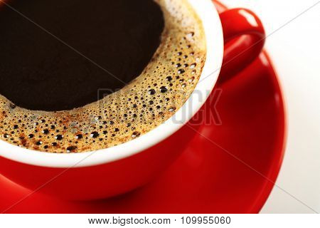A red cup of tasty coffee, close-up