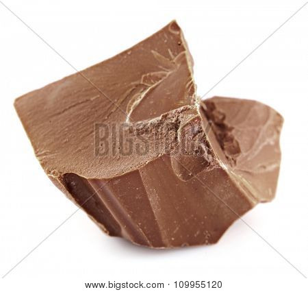 Milk chocolate piece isolated on white
