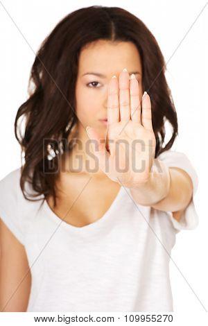 African teen woman making stop gesture.